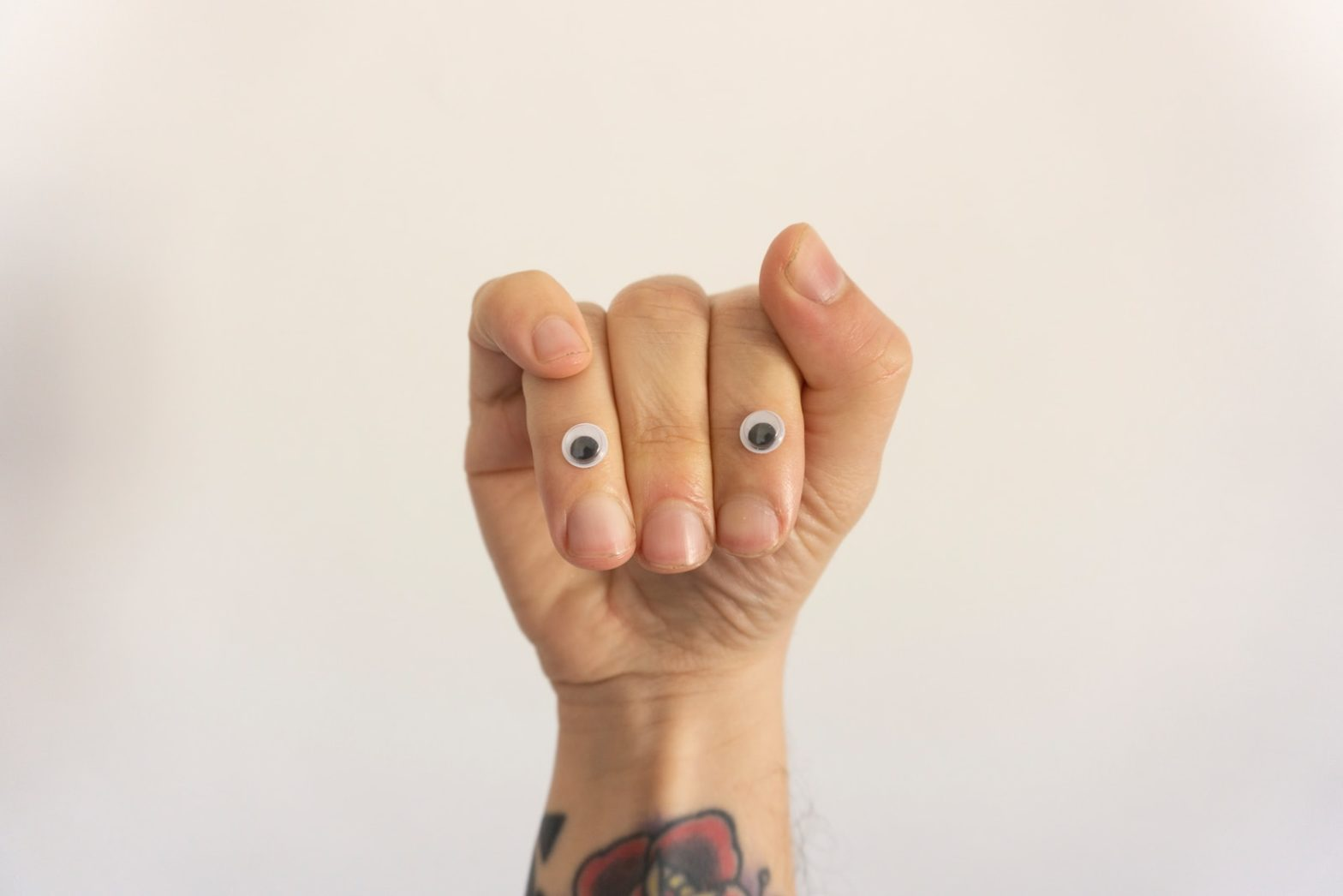 person with black and red manicure