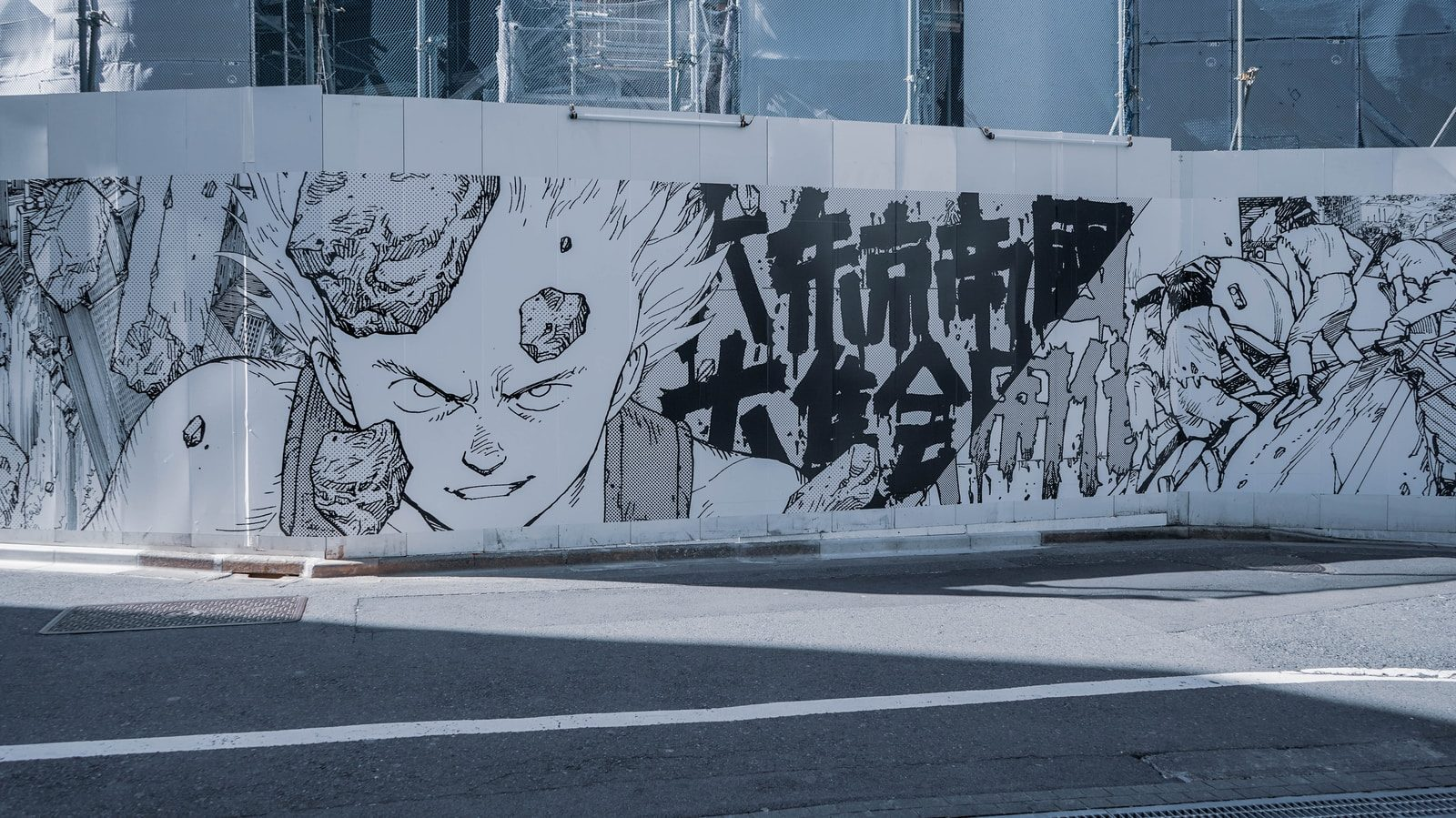 white and black graffiti on white wall